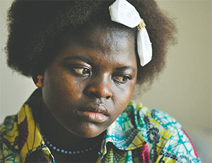 Monique Ngomba, 16, is shown at home last April in the northeast Baltimore apartment she shared with her parents and younger brother. The Ngomba family is from the Central African Republic, and lived in refugee camps in Chad for 11 years. Monique is the only student at Patterson who speaks Sango, and learning English has been very difficult.(PHOTOS BY AMY DAVIS/BALTIMORE SUN/TNS)