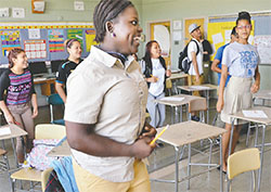 Shown up front, Monique Ngomba and other students laugh during an exercise in an ESOL class taught by Jill Warzer at Patterson High School last spring.