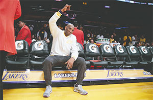 Lakers forward Kobe Bryant waves to fans during warmups before a game against the Indiana Pacers on Nov. 29 at Staples Center in Los Angeles. (ROBERT GAUTHIER/LOS ANGELES TIMES/TNS)