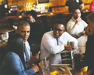 On Tuesday, President Obama had lunch with Teana Dowdell from UAW Local 22, left; emergency doctor Tolulope Sonuyi, center; Tom Kartsotis, right; and Detroit Mayor Mike Duggan.(ROMAIN BLANQUART/DETROIT FREE PRESS/TNS)