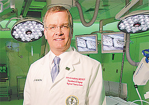 Florida Surgeon General John Armstrong intends to use his medical knowledge and experience to benefit himself and others in his personal battle against colon cancer.  (COURTESY OF THE UNIVERSITY OF SOUTH FLORIDA)