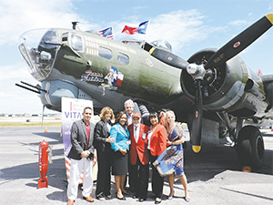 Standing from left to right in front of the B-17 Bomber Aircraft on March 23 are Co-Chair of Honor Flight South Florida Ryan Paton, VITAS Veteran Liaison Karin Edelstein, VITAS General Manager Donna Borland, VITAS Director of Market Development Peter Viebrock, Retired USAF Tuskegee Airman Lt. Col. Leo R. Gray, VITAS Community Liaison and member of the Tuskegee Airmen Miami Chapter Deborah Mizell, and VITAS General Manager Susan Acocella.
