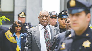 Bill Cosby is escorted from the courthouse after attending his preliminary hearing at the Montgomery County Courthouse on May 24 in Norristown, Pa. The judge in that case ruled there was sufficient evidence for a sex abuse case against the comedian to proceed to trial.(ED HILLE/PHILADELPHIA INQUIRER/TNS)