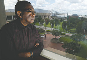 Baton Rouge Mayor Kip Holden gazes out his office window onto the Mississippi River area of his community on July 19.(MARK BOSTER/LOS ANGELES TIMES/TNS)