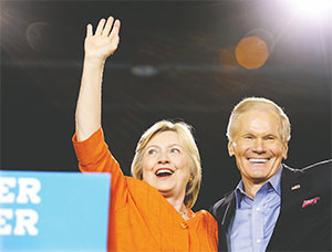Democratic presidential nominee Hillary Clinton responds to cheering supporters as she was welcomed by Florida Sen. Bill Nelson in Kissimmee while on a campaign swing through the state in August.(JOE BURBANK/ORLANDO SENTINEL/TNS)