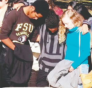 Students comfort each other the morning of Nov. 20, 2014 after the previous night's shooting at Florida State University's Strozier Library in Tallahassee. Between the 2014 and 2015 academic years, counseling center at FSU has seen an increase of 19 percent in student visits.(KATHLEEN MCGRORY/MIAMI HERALD/TNS)