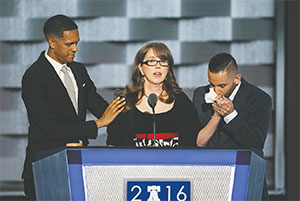Christine Leinonen, mother of Christopher Leinonen, flanked by Orlando nightclub survivors Brandon Wolf and Jose Arraigada, speaks at the Democratic National Convention in Philadelphia on July 27. Christopher Leinonen was killed in the Pulse nightclub shooting. (MARCUS YAM/LOS ANGELES TIMES/TNS)