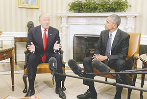 President Barack Obama meets with President-elect Donald Trump on Nov. 10 in the Oval Office of the White House in their first public step toward a transition of power. (OLIVIER DOULIERY/ABACA PRESS/TNS)