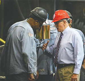 Then Republican vice presidential candidate Mike Pence talks with workers before speaking about trade and the economy at a private event at Charlotte Pipe and Foundry on Aug. 24 in Charlotte, N.C. (DAVIE HINSHAW/CHARLOTTE OBSERVER/TNS)