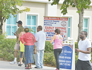 Voters line up for to cast their ballot early at Broward County library Miramar Branch during the Presidential 2016 election on Oct. 24 in Miramar. Voting rights advocates are trying to make sure that voting is safe and fair at polling places around the country.(JOHNNY LOUIS/SIPA USA/TNS)