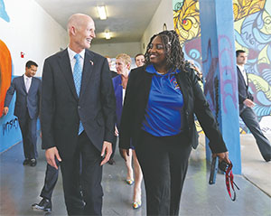 Florida Gov. Rick Scott visits Dr. April Thompson-Williams, principal at Jose De Diego Middle School in Miami on Aug. 22. The students at the school had been learning about the Zika virus and the ways to prevent it. (PATRICK FARRELL/MIAMI HERALD/TNS)