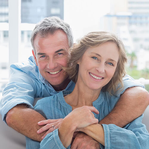 Middle-age-couple-smiling-and-hugging