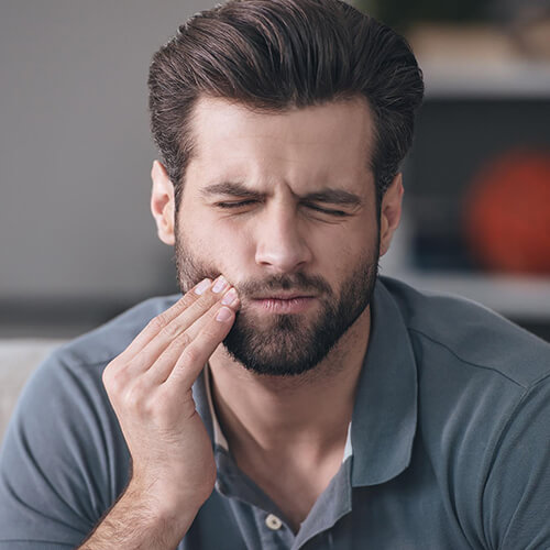 Young-man-with-toothache