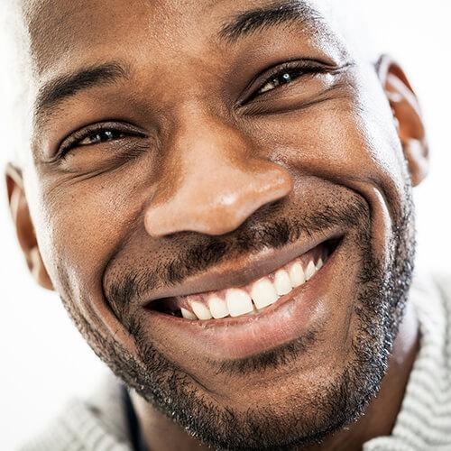 man-smiling-up-close