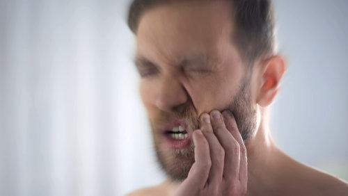 Sharp-Toothache-Disturbing-Man