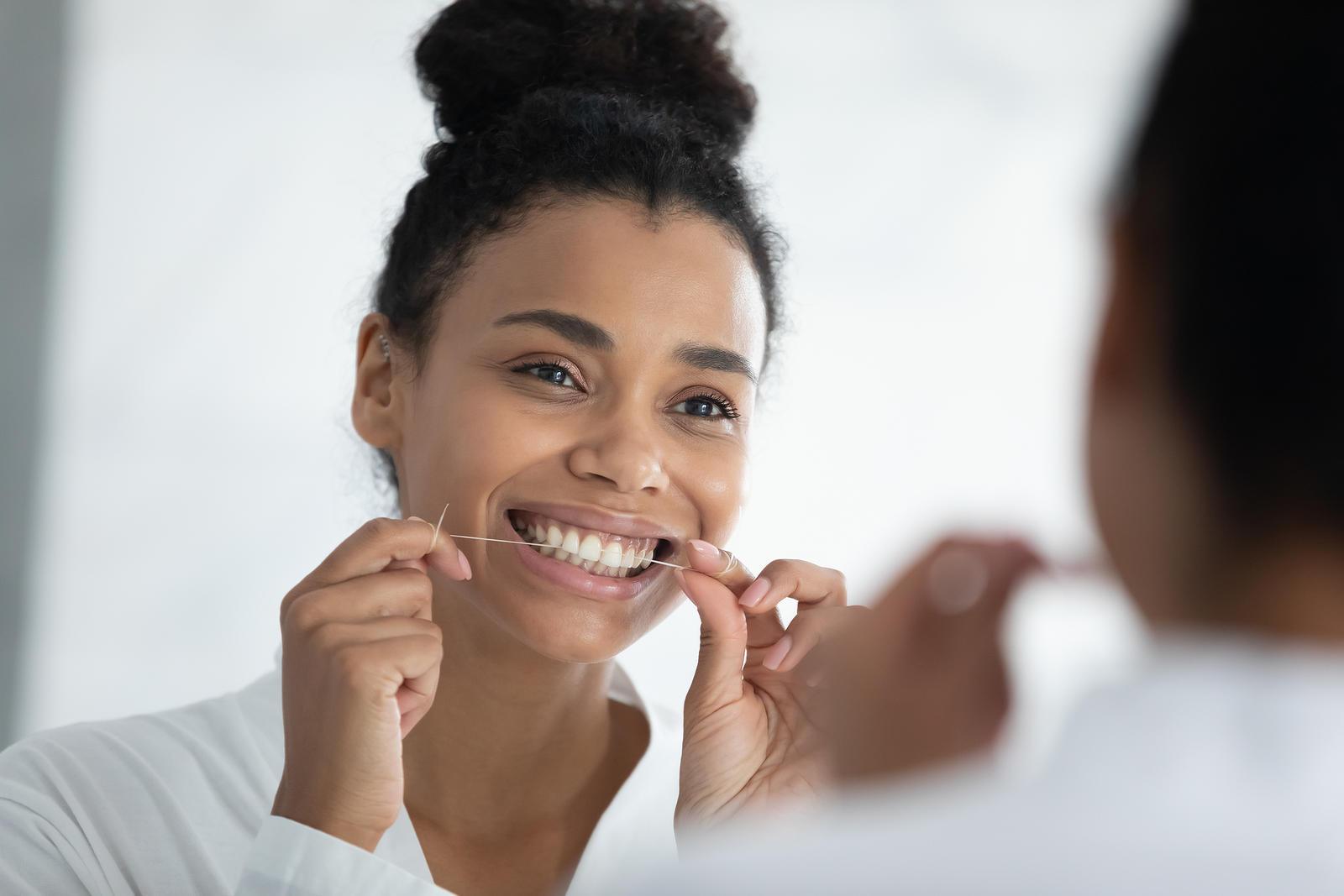 Woman-flossing
