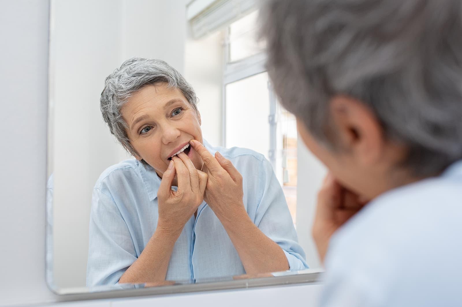 mature-woman-flossing