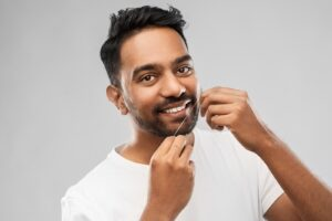 Gum-Health-Man-Flossing