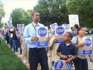 The York community rallies against privatization of public education.