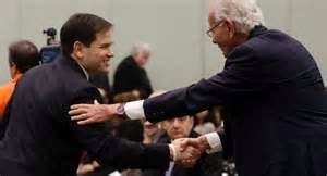 "Prez candidate Marco Rubio (R-FL) bows to rich car dealer Norman Braman, ""the man in France."""