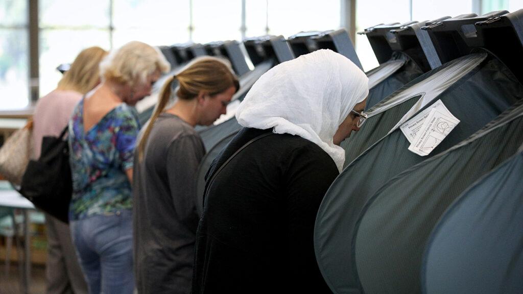 Women exercising their right to vote.
