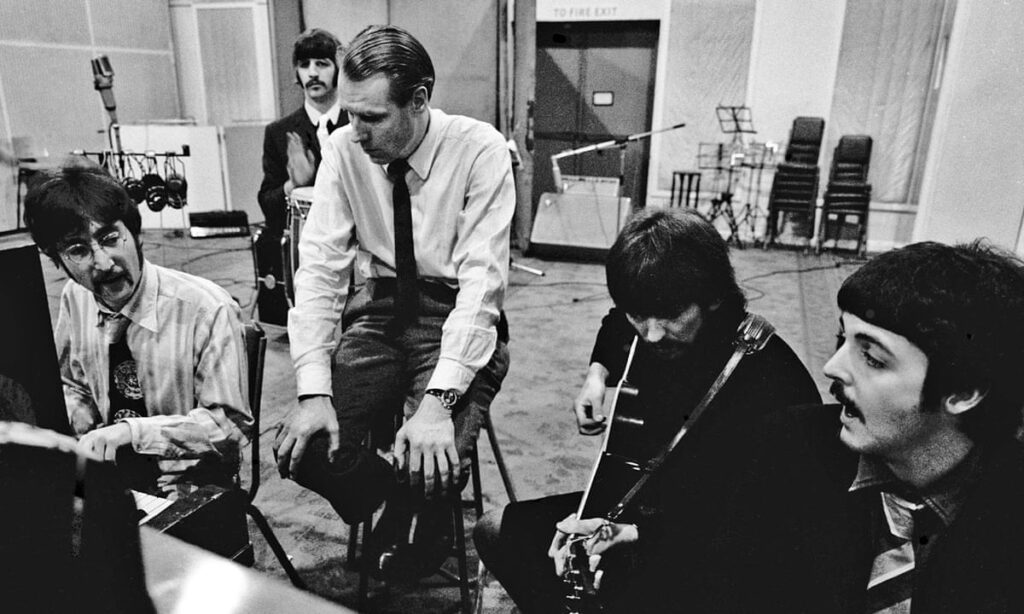 The Beatles and producer George Martin.