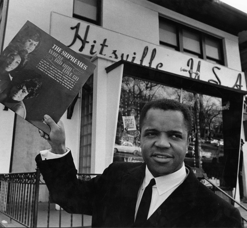 Berry Gordy with Motown Records in the background.