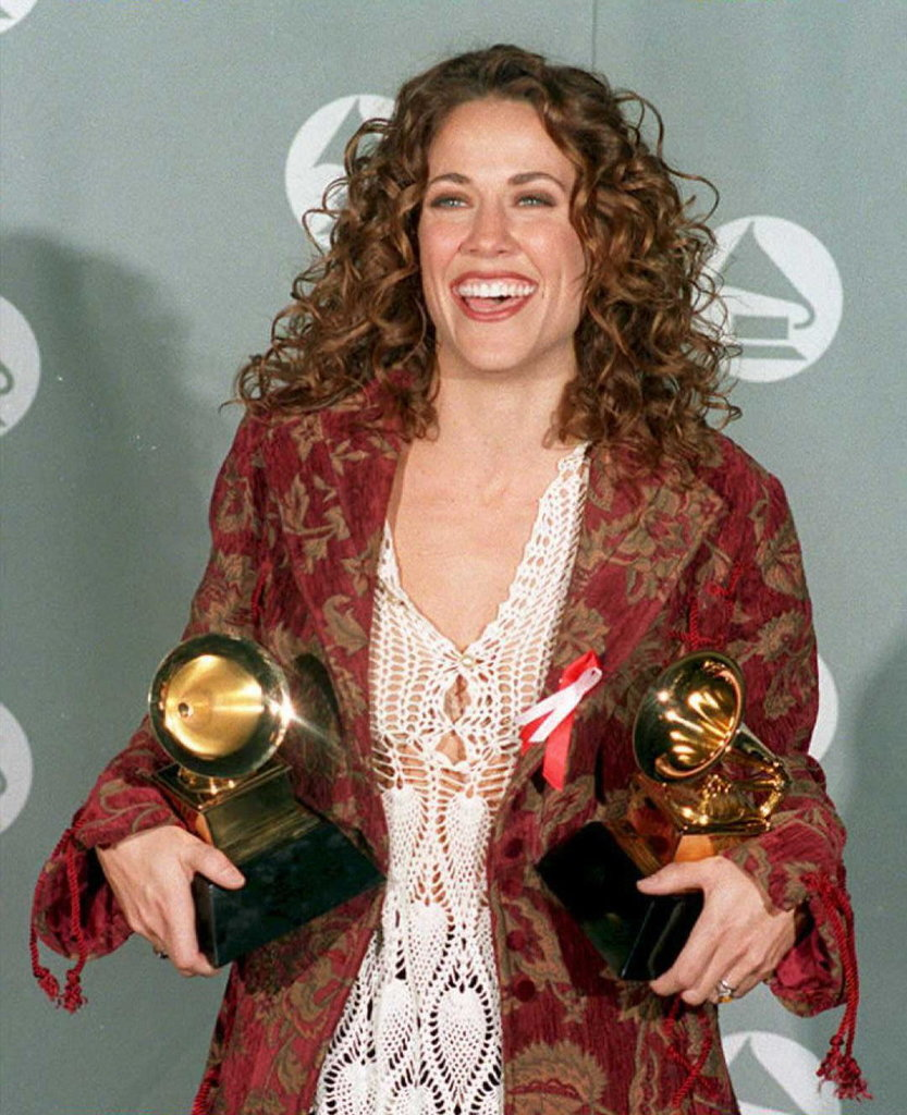 """Sheryl Crow holding Grammy Awards for her 1994 song, """"All I Wanna Do."""""""
