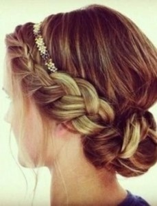 """This look can be achieved by adding one or two braids, loosening them up, and lightly pinning  coiled braid into a bun at the nap of your neck..or slightly to the side. Very chic and relly not hard to """"Holi do!"""""""