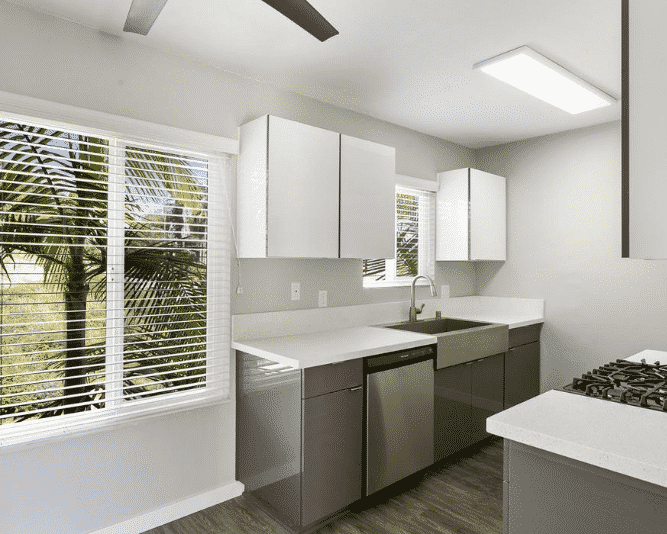 Kitchen with a window, Stainless Steel Appliances, and quartz counters