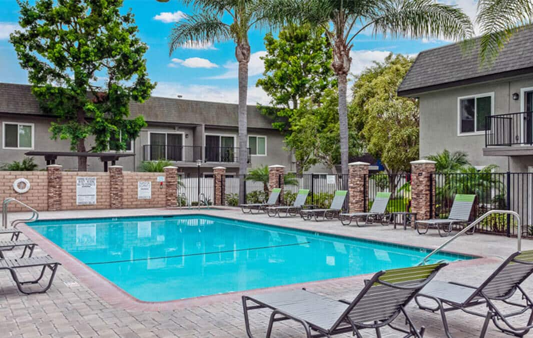 Beachwood Apartment pool and lounging area