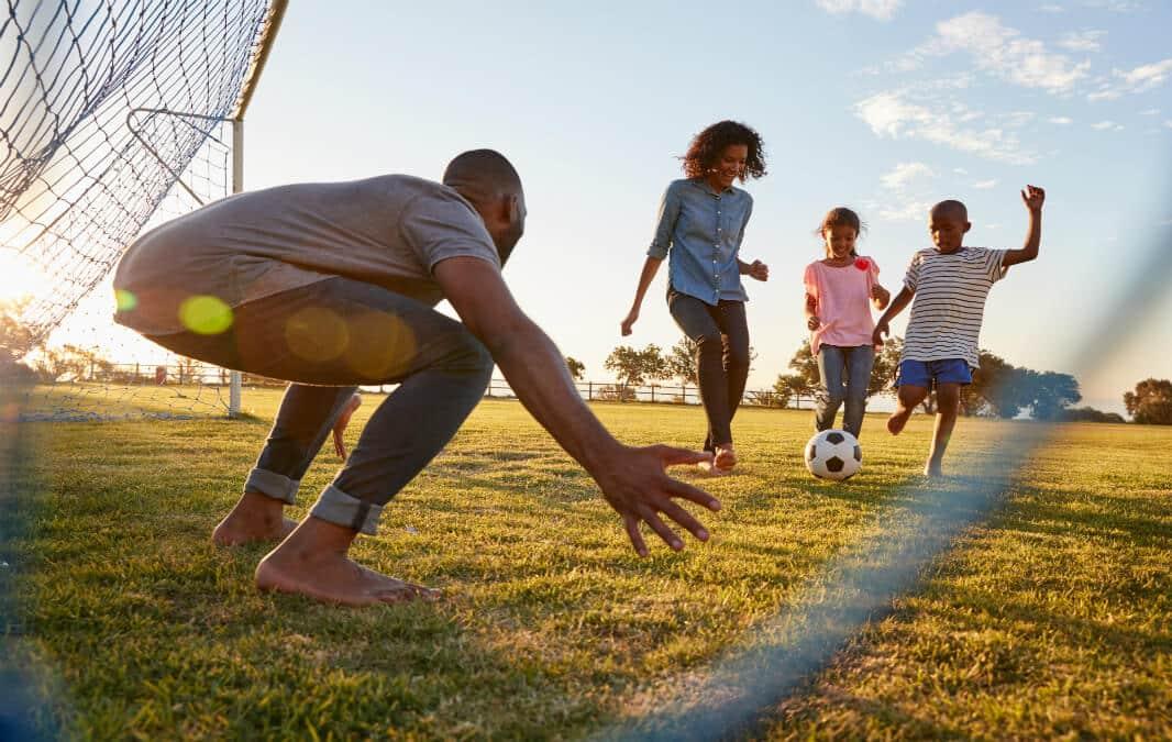 Happy family enjoying football games