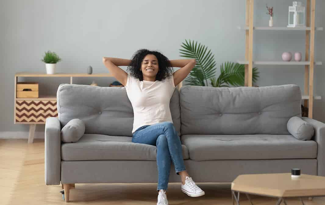 woman sitting on couch at home