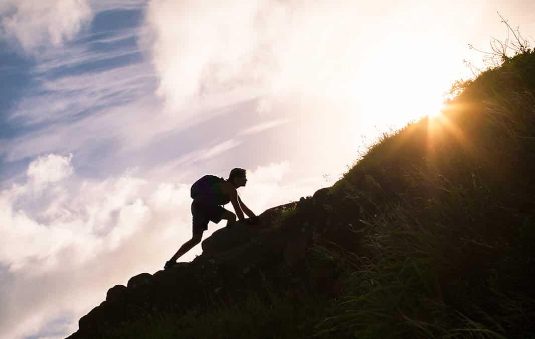 person climbing a mountain