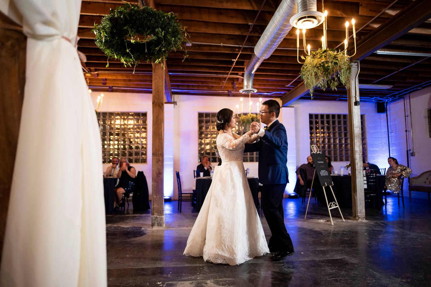 Bride and Groom Danceing with Uplighting in background