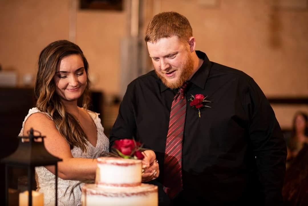 Couple Cutting Their Wedding Cake Beth Waterman Photography