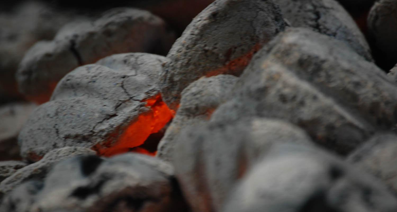 fire smoldering under hot coals