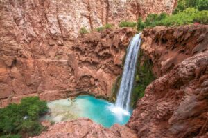 Swim Under The Havasu Falls In The Grand Canyon, USA