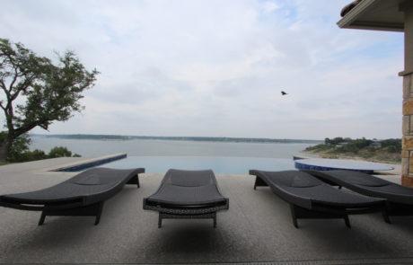 Lounge chairs near pool over Belton Lake