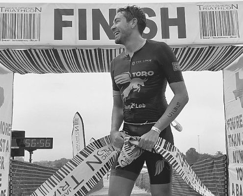 2019 Jack's Generic Tri champion, Pablo Gomez, crosses the 17th annual JGT finish line.