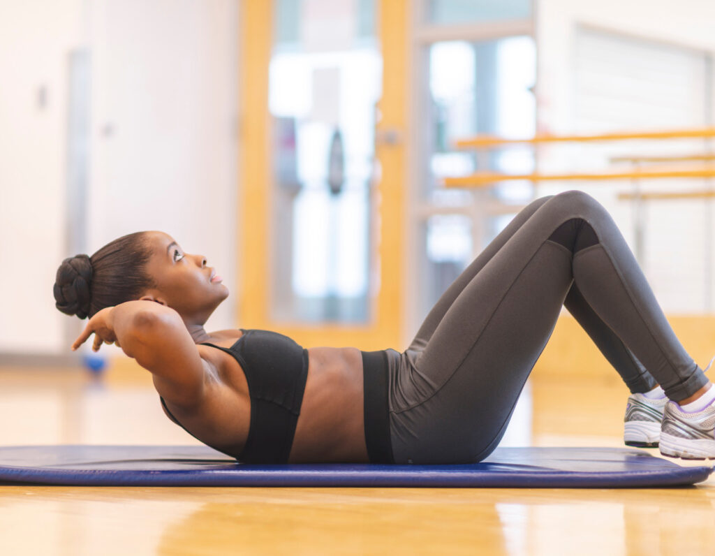 Fit woman doing ab work after pregnancy