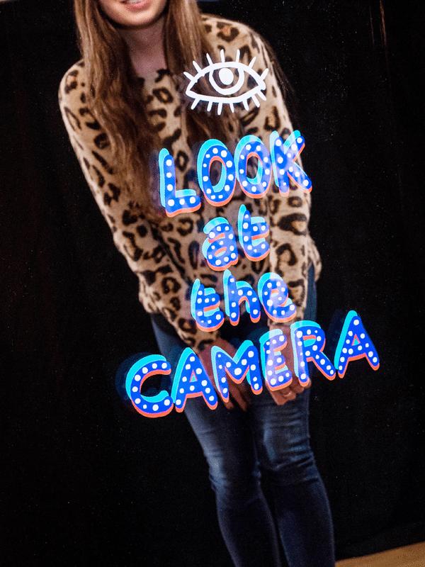 Woman looking at camera in Magi Mirror