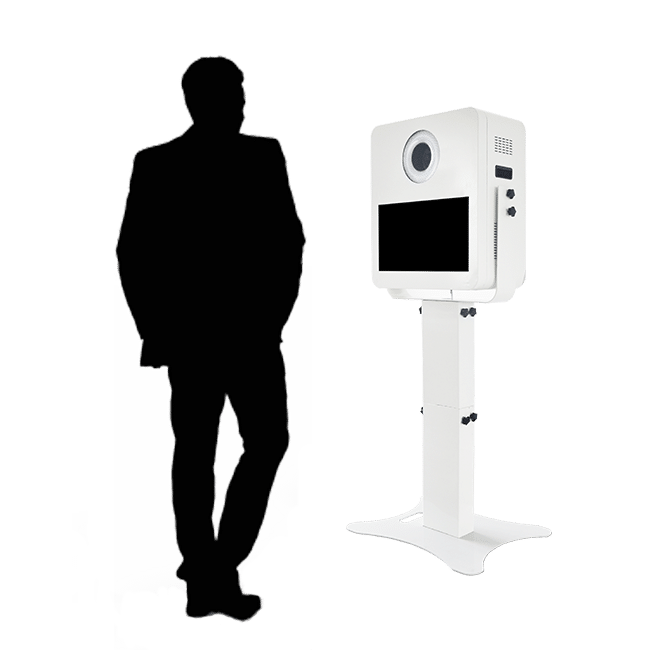 Man standing in front of photo booth kiosk