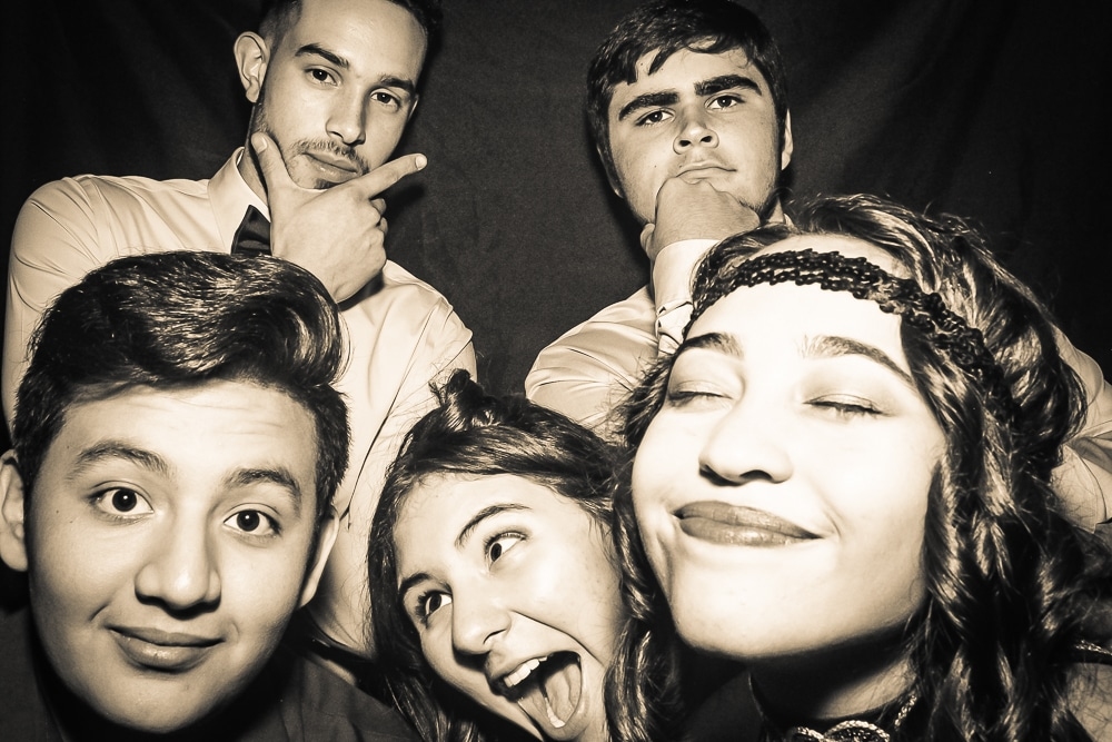 Young group of kids in photo booth