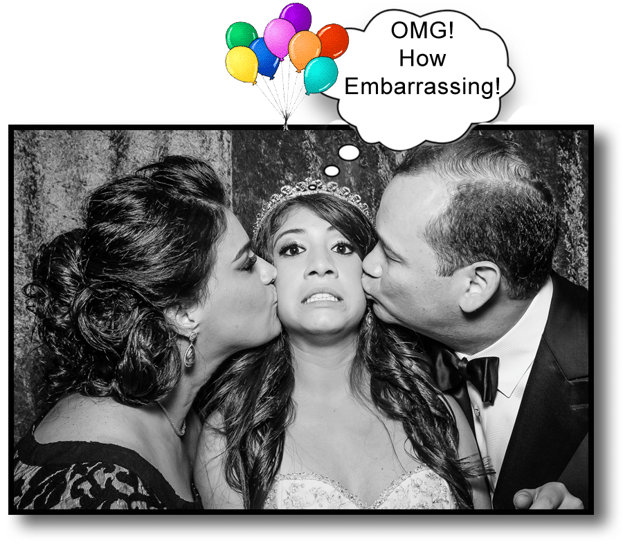 Parents kissing girl in photo booth