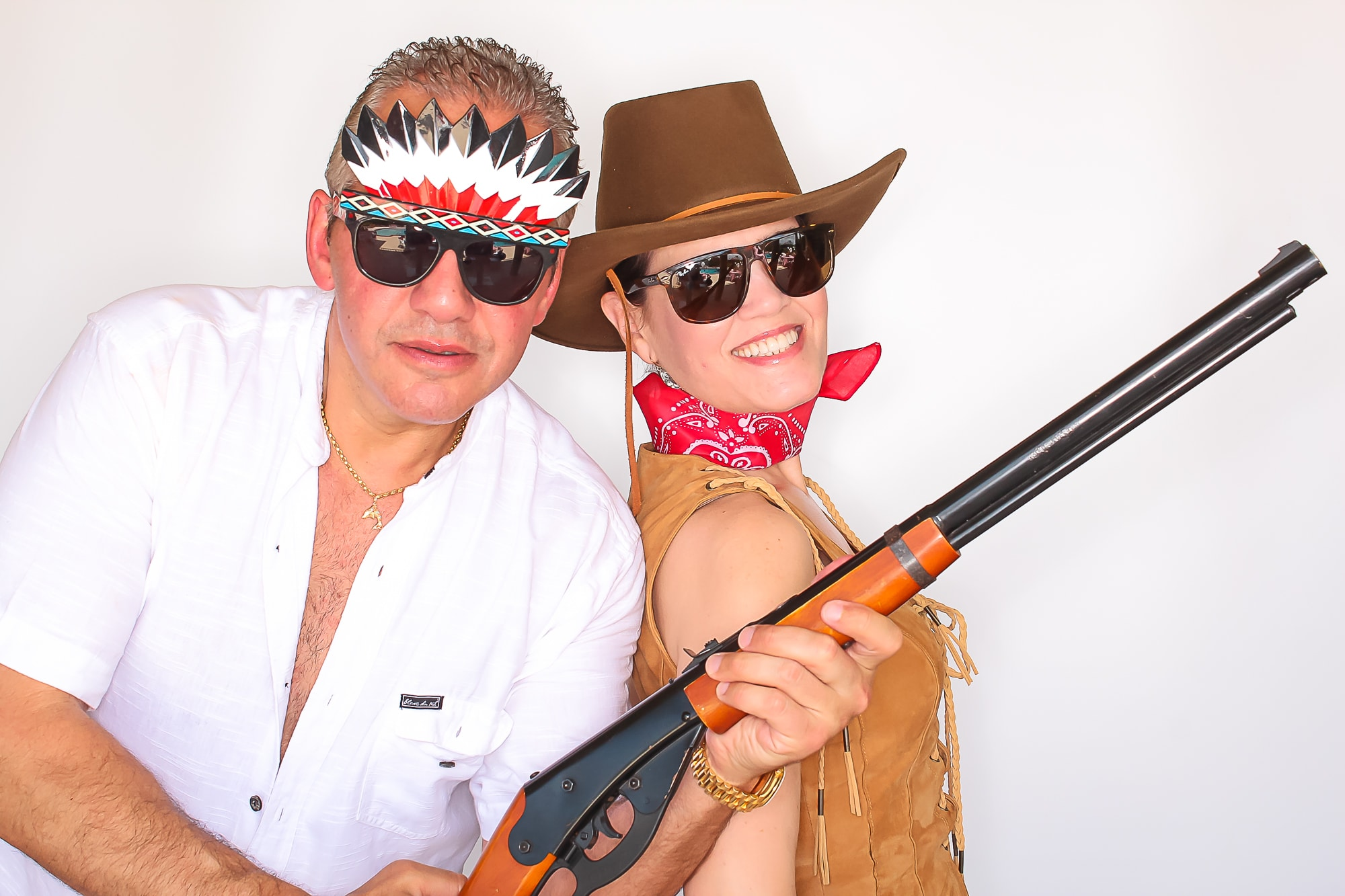 Cowboy and cowgirl with rifle
