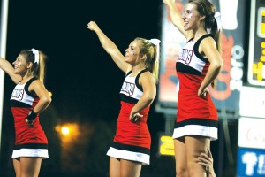 The Youngstown State University cheerleaders chant during the football home opener against Dayton on Thursday. Photo by Dustin Livesay/The Jambar