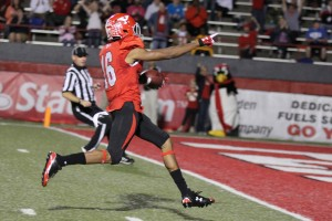Youngstown State University wide receiver Marcel Caver (16) points toward the end zone after beating the final Illinois State defender to complete a 67-yard touchdown reception with 11:02 left in the second quarter. Caver finished the game with 99 receiving yards during YSU's 59-21 victory over the Redbirds.  Photo by Dustin Livesay/ The Jambar.