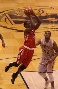 Youngstown State's Kendrick Perry  (3) puts up a jump shot while being defended by Kent State's Darren Goodson (42) during the second half of Wednesday night's matchup at Kent State University.  Dustin Livesay/The Jambar.