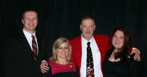 Daryl Mincey (middle) poses after winning the Penguin of the Year Award in 2013. Mincey had work for the FDA since October 2004 and has been a professor at YSU since 1991.